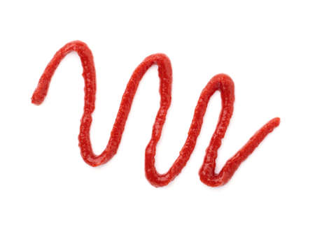 ketchup lines isolated on a white background close-up. figures from the tomato sauce