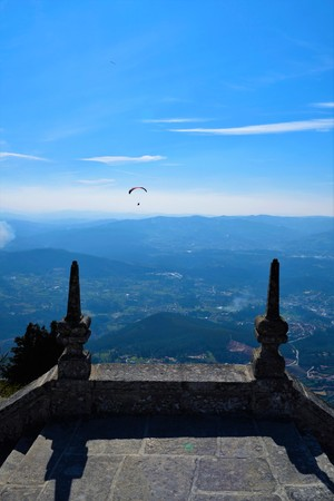 paraglider: A paraglider over the countryside