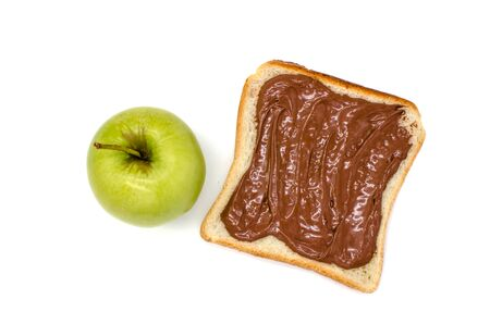 green apple and bread with chocolate paste on a white background isolated Standard-Bild - 129194920