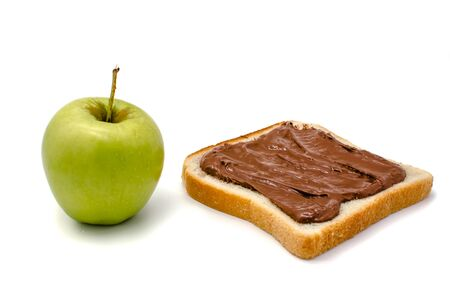 green apple and bread with chocolate paste on a white background isolated Standard-Bild - 129150060