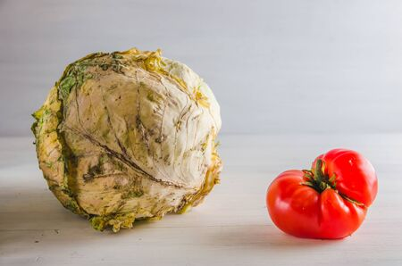 ugly food cabbage and tomato on a white background