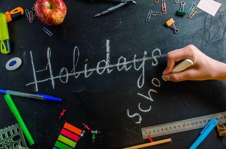 soon to school September 1 inscription on a black chalk board