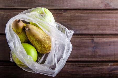 concept plastic free fruit in a plastic bag on brown background with copy space Stock fotó