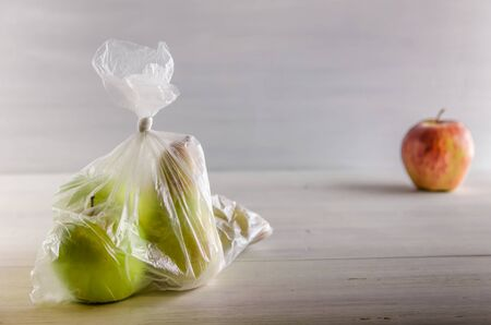 concept plasic free fruit in a plastic bag on white background with copy space