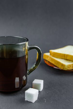 morning tea and toast on a black background.