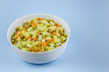 Russian salad Olivier with potato carrot green peas