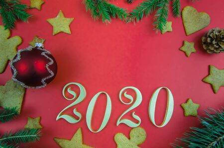Christmas, New Years red background. gingerbread. spruce twigs