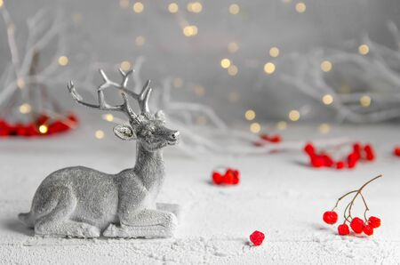 Christmas. New Years composition of silver deer and red rowan. garland lights. fairy forest Stock fotó