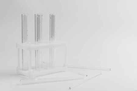transparent test tubes on a white background of chemistry experiments