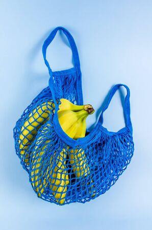 bananas in a blue bag. no plastic, free plastic