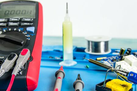 The electrician's workplace. Electronics. Schemes soldering iron. multimeter