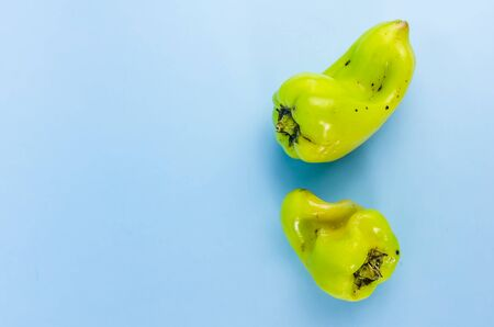 ugly food. green pepper on a blue background. copy space Stock fotó