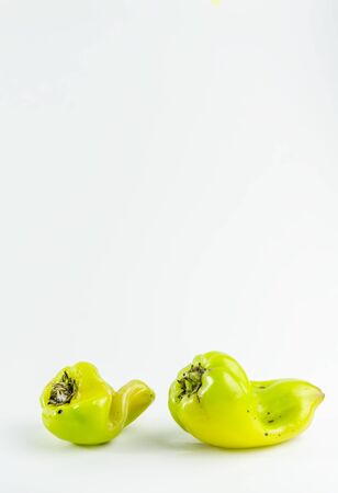 ugly food. green pepper on a white background. copy space