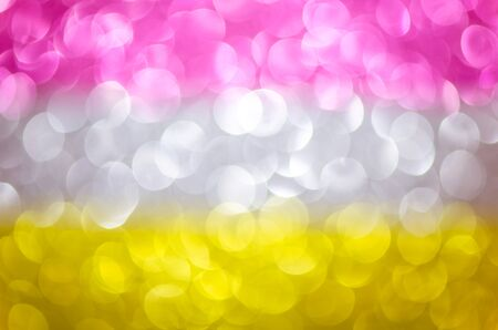 Abstract glitter three color lights background. de-focused. pink, silver, yellow