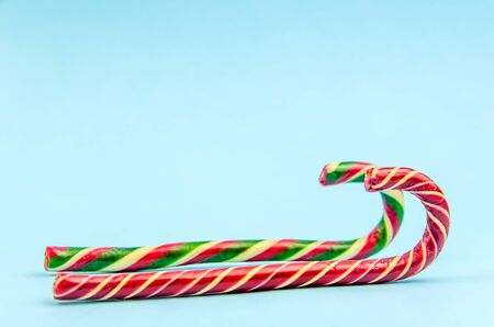 Christmas background. Two different Christmas candy canes. sleigh, copy space