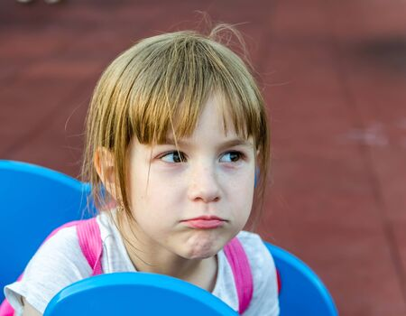 Little girl made a funny face. outdoor