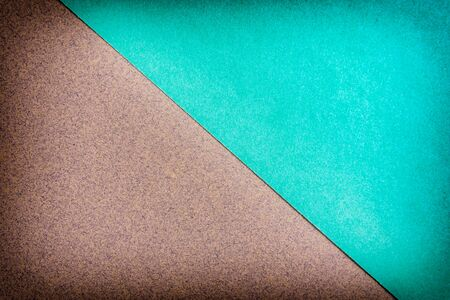 Multicolor paper diagonal background with arrow of trendy mint and craft colors.