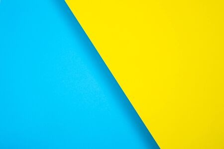 Colored paper background. bright color, blue and yellow. diagonally, with a shadow. For design, text