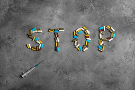 Drugs, syringe and pills. The inscription stop. Concept stop virus, coronavirus