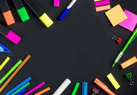 flat lay stationery on a black background