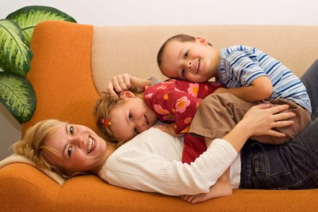Happy woman and kids having fun indoors Stock Photo - 2753425