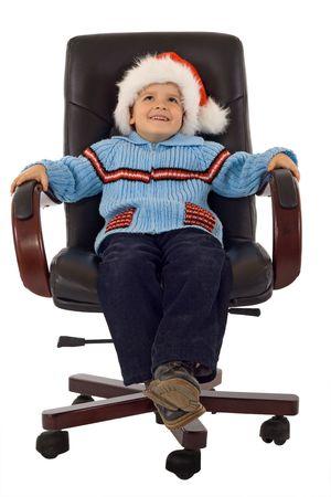 Happy boy waiting santa in a revolving armchair - studio shot - isolated Stock Photo - 2753419