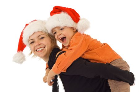 Woman and little boy playing in santa hats - studio shot - isolated Stock Photo - 2753415