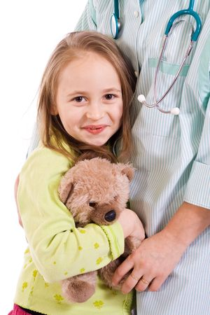 Little girl smiling, standing near a pediatrician or a nurse - isolated Stock Photo - 2753424