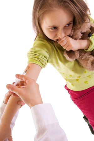Worried and afraid little girl receiving an injection - studio shot - isolated Stock Photo - 2753417