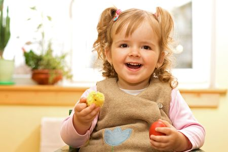 Happy girl with easter egg and decoration in hands Stock Photo - 2753416