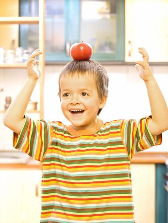 Happy boy with apple - balanced diet concept Stock Photo - 2780378