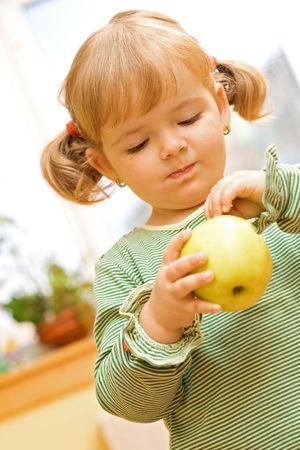 Two years old girl playing with apple Stock Photo - 2791794