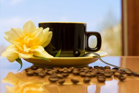 Coffee on a table in a beautiful morning photo