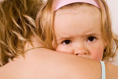 Little girl cuddling with her mother - closeup Stock Photo - 2946581