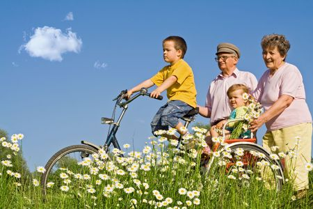 Ride with grandparents among daisies photo