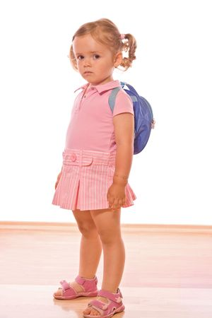 kindergarden: Little girl not too happy about going to school or kindergarden - isolated