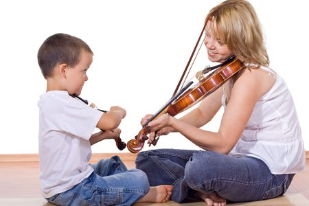 Little boy and woman sitting on the floor practicing the violin - isolated photo