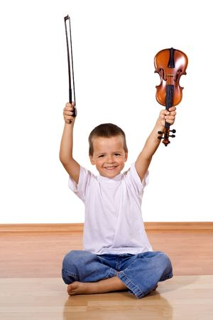 Happy little boy with a violin - isolated photo