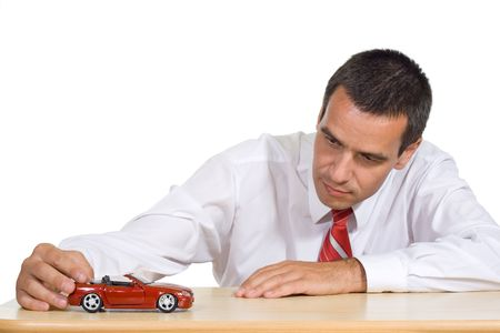 dream planning: Businessman planning to buy a new luxury car - isolated