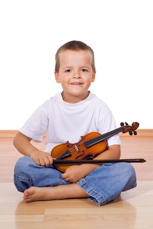 Boy sitting on the floor with violin - isolated photo