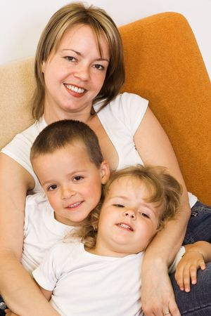 Woman with her kids on the sofa photo