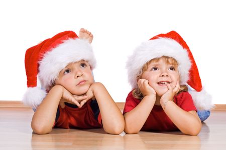 Two kids dreaming about christmas photo