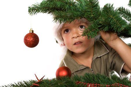 Boy with santa hat lurking in wait for Santa  photo