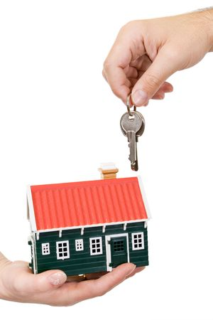 Hands holding miniature house and keys - isolated photo