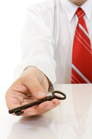 Businessman hand with old key - isolated photo