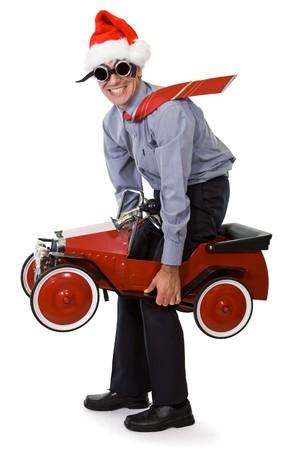 voiture ancienne: Homme d'affaires � Santa chapeau au budget vieille voiture - isol� Banque d'images
