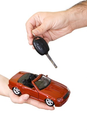 Woman and man hands with red sports car and key - isolated Stock Photo - 3946244