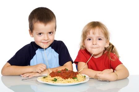 Happy kids eating pasta - isolated Stock Photo - 3976587