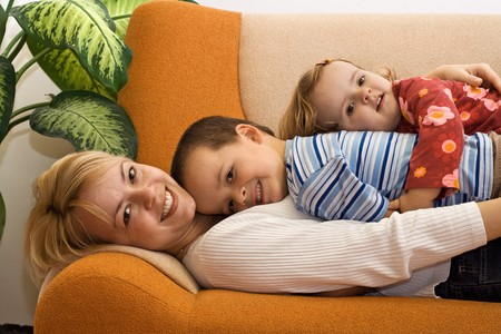 Woman and children together at home photo