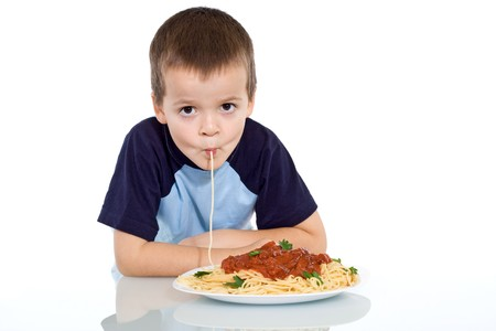 sipping: Boy eating pasta - sipping it up - isolated